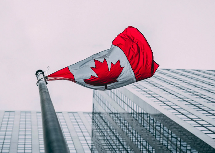 Canada flag in front of a building