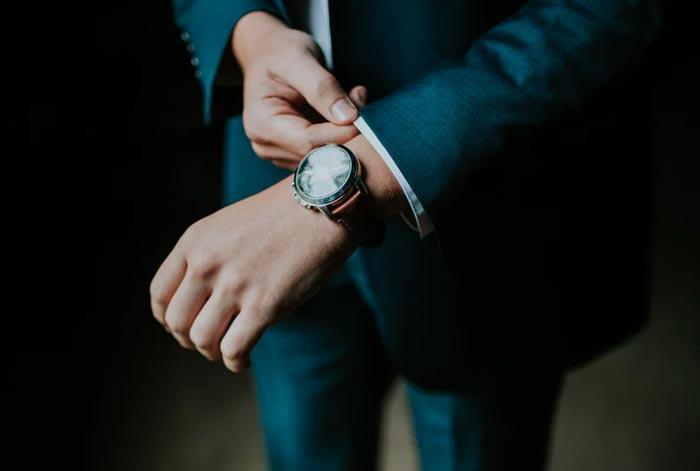 business man adjusting his sleeve