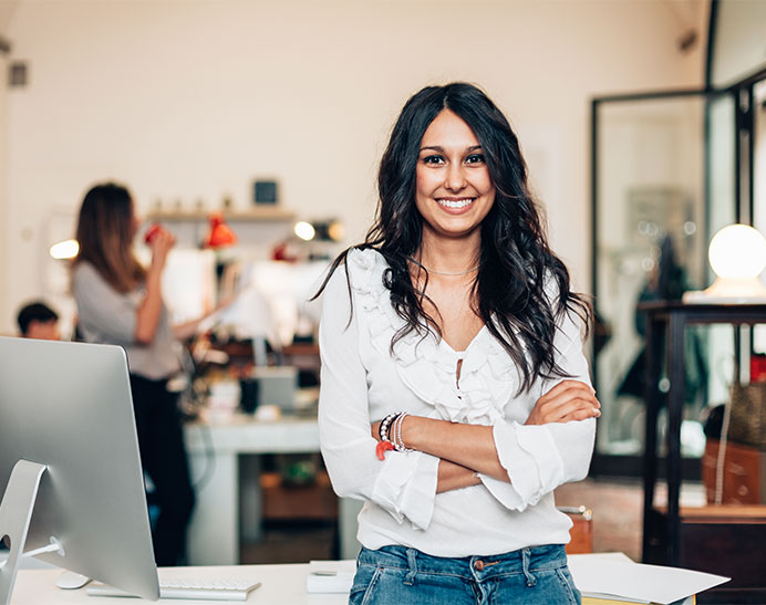 cheerful woman standing as a business owner