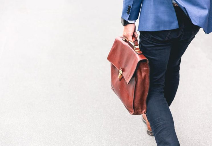 business man walking with a brief case