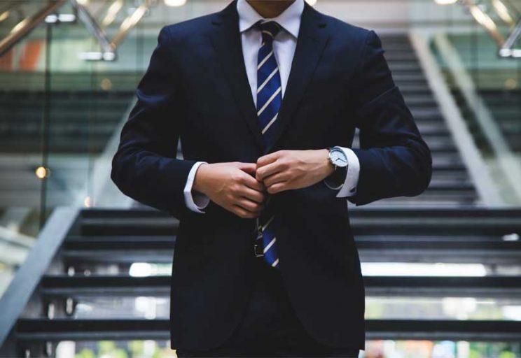 business man closing his jacket