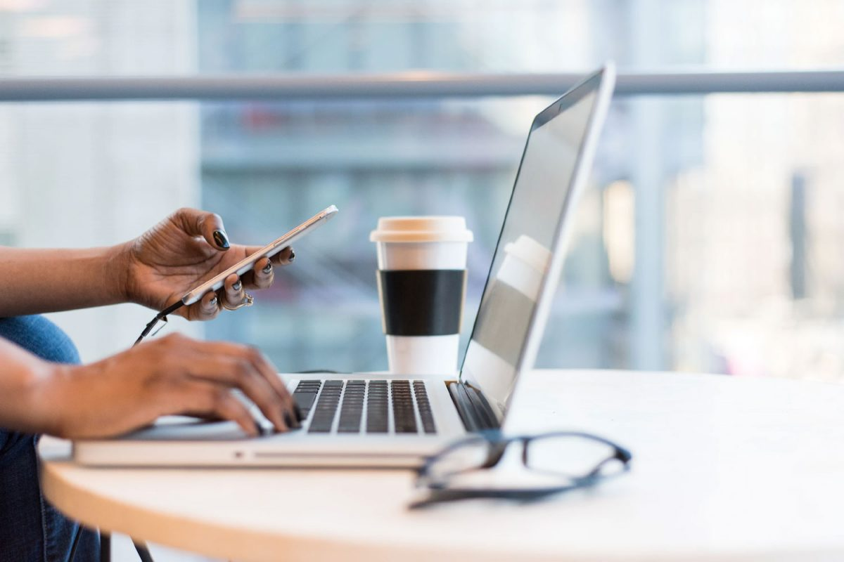 woman working remotely with smartphone