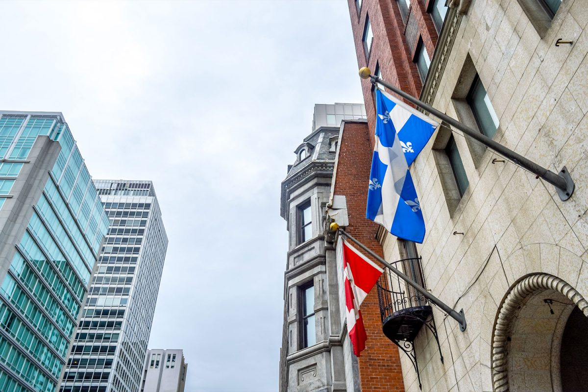 quebec flag and canada flag on building
