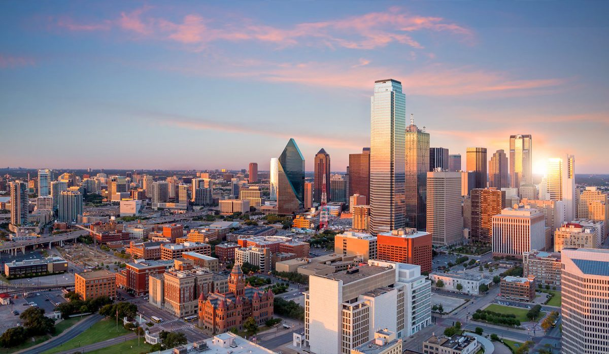Dallas Texas cityscape with blue sky at sunset