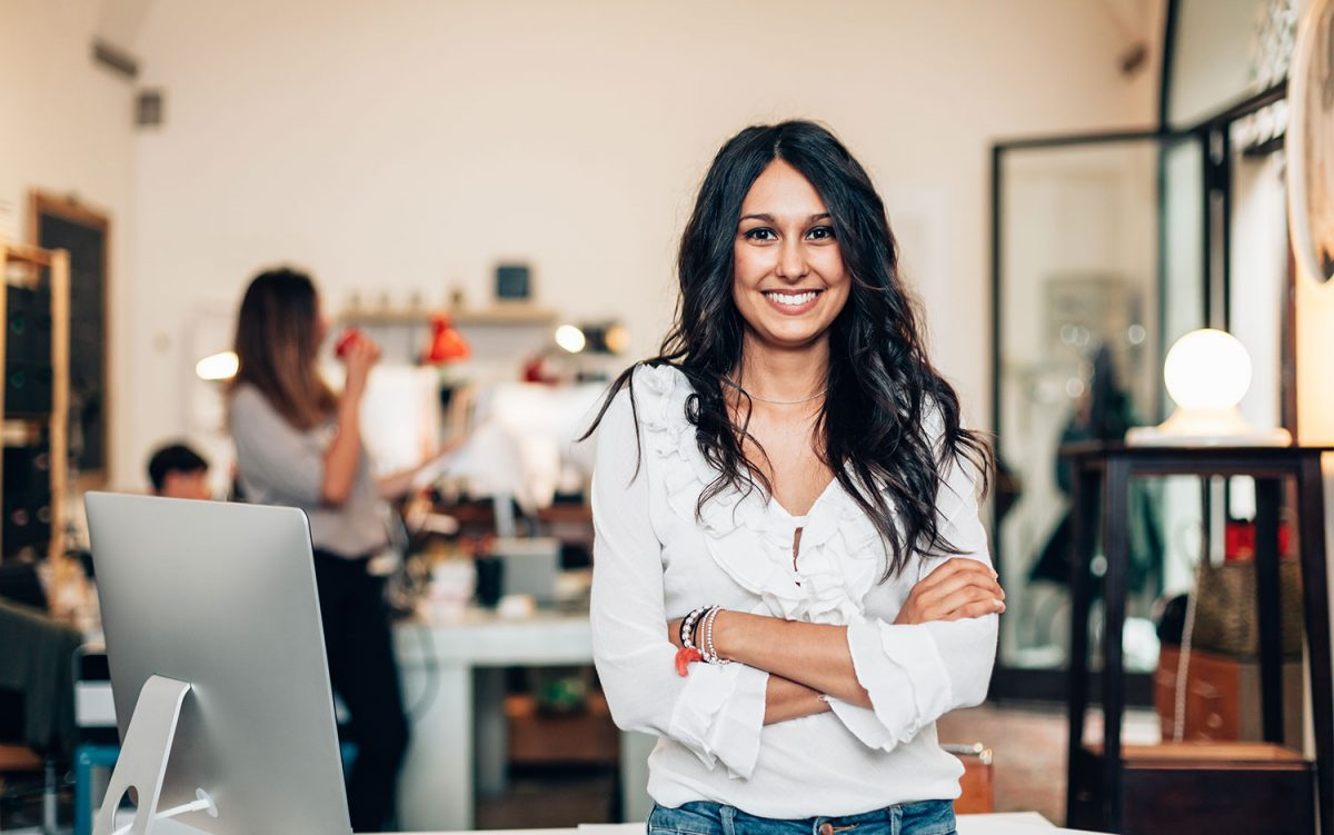 smiling business woman in work office